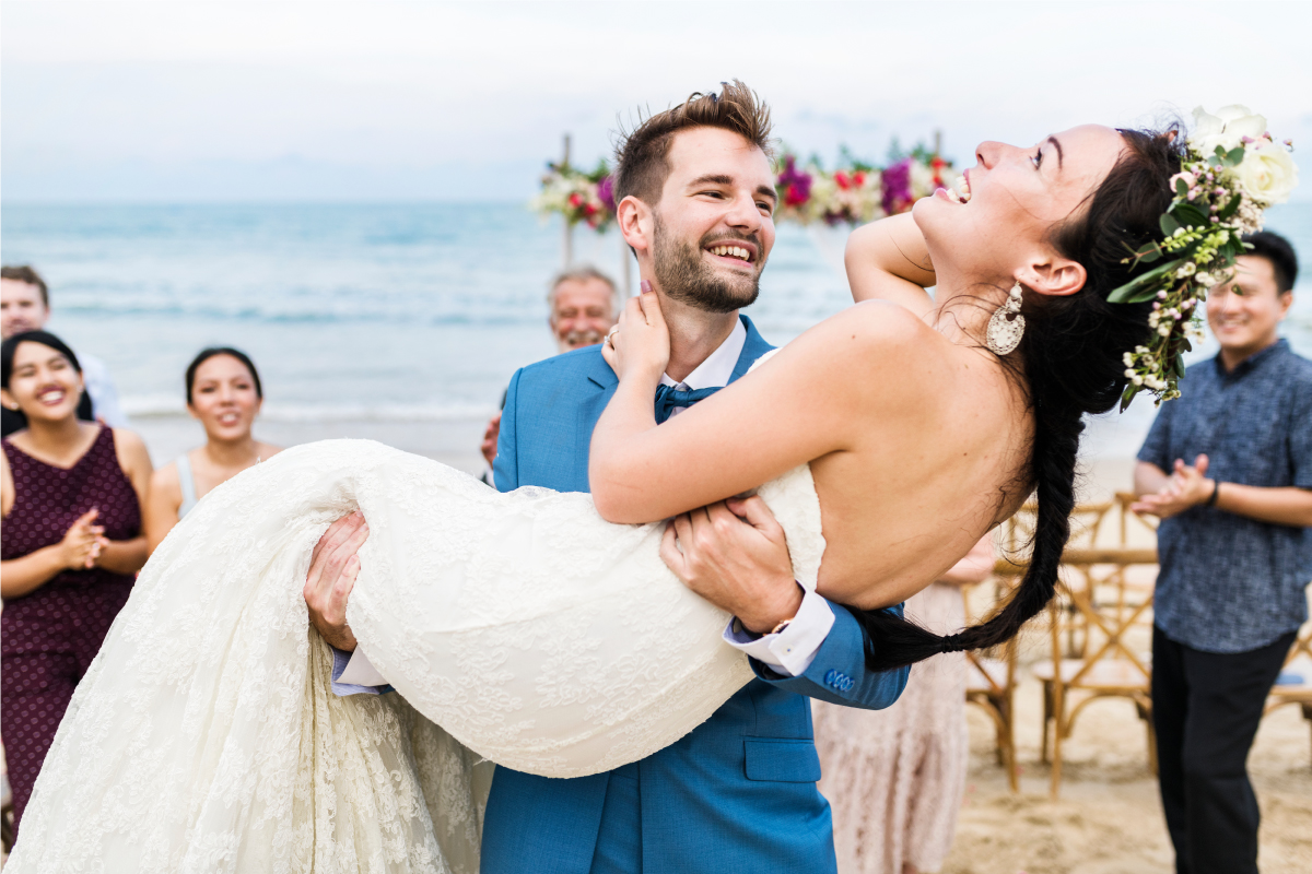 Cheerful Newlyweds at a Beach
